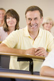 Senior man listening to a university lecture.  Royalty Free Stock Image