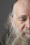 Senior Man With Long Beard. With eyes shut royalty free stock photo