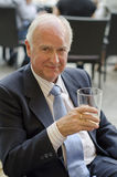 Senior man looking atthe view with alcohol glass Stock Photos
