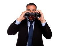 Senior man looking through binoculars Royalty Free Stock Photos
