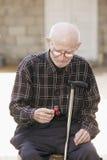 Senior man looking at cherry Royalty Free Stock Photo
