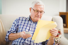 Senior man looking at a document Royalty Free Stock Image