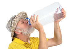 Senior man looking into empty bottle Royalty Free Stock Images