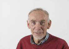 Senior man looking happy. Senior man with happy expression on gray background Royalty Free Stock Image