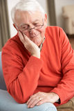 Senior Man Looking Sad At Home Royalty Free Stock Photo