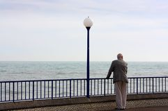 Senior man looking at sea in Eastbourne promenade in Sussex royalty free stock photos
