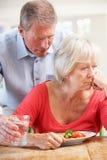 Senior man looking after sick wife Stock Photos