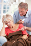 Senior man looking after sick wife Royalty Free Stock Photos