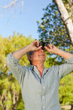 Senior man looking at the sky Royalty Free Stock Photos