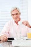 Senior man looking at smartphone royalty free stock photography