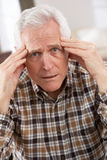 Senior Man Looking Stressed In Chair Stock Images
