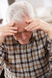 Senior Man Looking Stressed At Home Royalty Free Stock Photo