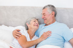 Senior man looking at wife in bed Stock Photos