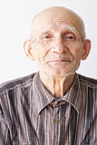 Senior man looks to camera Stock Images