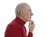 Senior man lost in thought. Profile of senior man thinking hard. White background royalty free stock photos