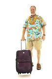 Senior man with luggage. Happy senior man with hawaiian shirt and flowers collar waiting with luggage on white background royalty free stock photography