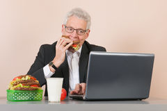 Senior man with lunch box at the office Royalty Free Stock Photography