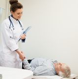 Senior man lying at doctor's office Royalty Free Stock Photos