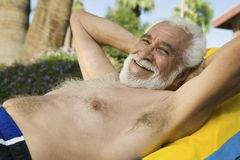 Senior Man Lying on sunlounger portrait. Royalty Free Stock Photos
