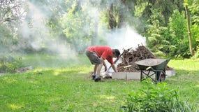 Senior man making a bonfire Stock Photos