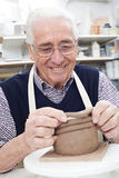 Senior Man Making Coil Pot In Pottery Studio Royalty Free Stock Images