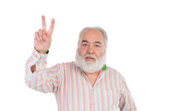 Senior man making the gesture of victory Stock Images
