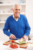 Senior Man Making Sandwich In Kitchen Royalty Free Stock Photography