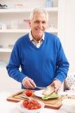 Senior Man Making Sandwich In Kitchen Royalty Free Stock Photography