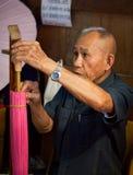 Senior man making a wooden um Royalty Free Stock Images
