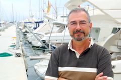 Senior man on marina sport boats portrait. Happy relaxed Stock Photo