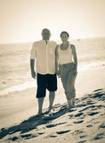 Senior man and mature woman together. Happy mature couple together at sea beach Royalty Free Stock Photography