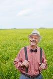 Senior man in meadow Stock Photos