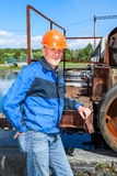 Senior man mechanist stands near sewage treatment plant Royalty Free Stock Photography