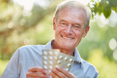 Senior man with medicament in his hands Stock Image