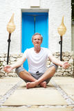 Senior Man Meditating Outdoors At Health Spa Stock Images