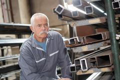 Senior man in metalworking factory. Metalwork stock images