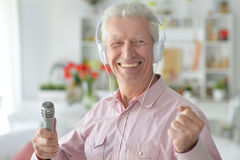 Senior man with microphone Stock Photography