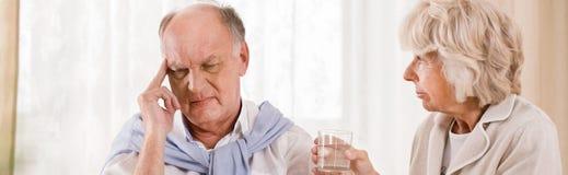 Senior man with migraine Stock Images