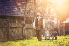 Senior man with milk kettle Royalty Free Stock Images