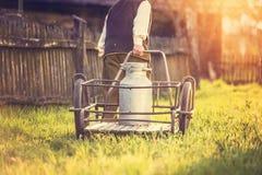 Senior man with milk kettle. Senior man carrying a milk kettle on his farm Royalty Free Stock Photography