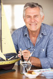 Senior man model making. Smiling at camera Stock Photography