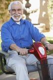 Senior Man On Motor Scooter Stock Photography