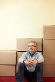Senior man with moving boxes Royalty Free Stock Photography