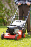 Senior man mowing grass Royalty Free Stock Images
