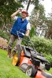 Senior man mowing the lawn. royalty free stock photos