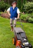 Senior man mowing lawn. royalty free stock photography