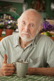 Senior man with mug Stock Photography