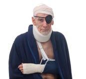 Senior man with multiple injuries stock image