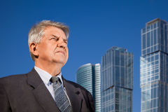 Senior man near skyscrapers construction Royalty Free Stock Image