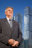 Senior man near skyscrapers construction Royalty Free Stock Photo